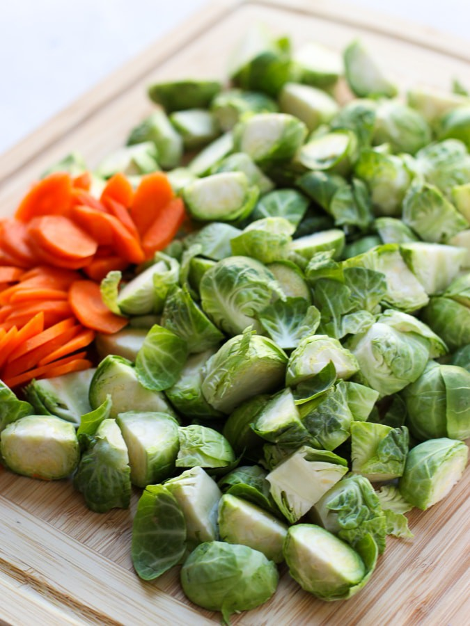 Uncooked Brussel sprouts and carrots for Sautéed Garlic Brussel Sprouts and Carrots