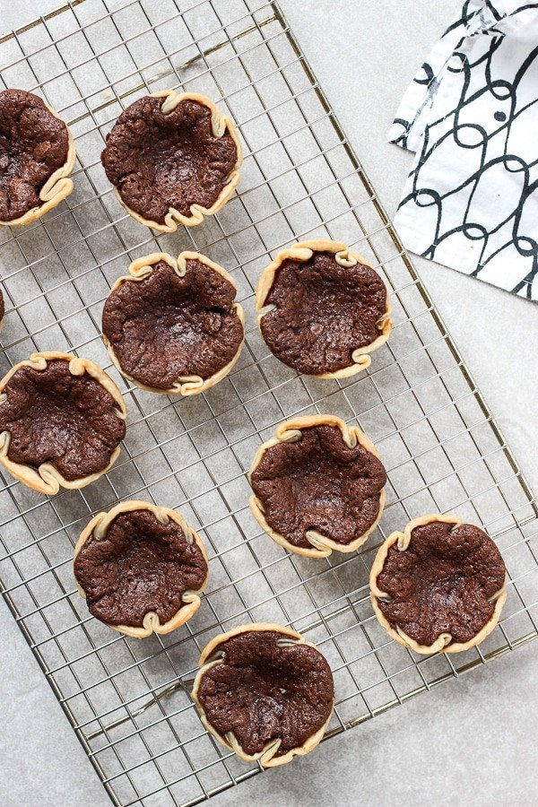 Cooling a batch of freshly baked Mini Chocolate Chess Pie on baking rack