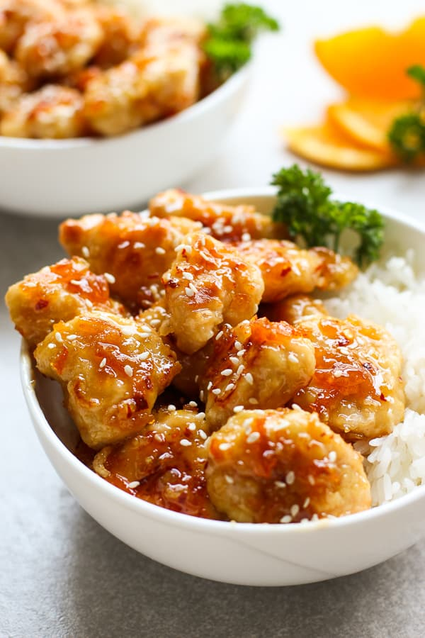 A bowl of Easy Baked Orange Chicken on top of rice