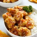 A bowl of Easy Baked Orange Chicken with rice