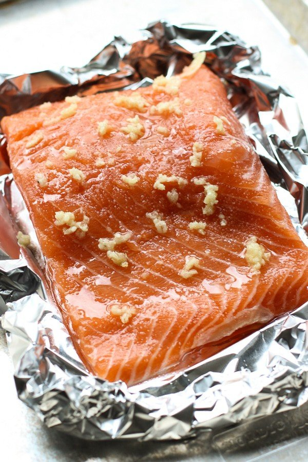 Uncooked salmon with seasoning for Baked Salmon Sushi Bowl