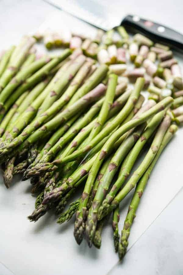 Cutting stems of asparagus