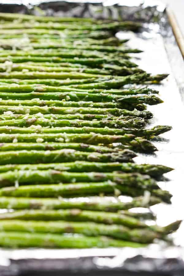 Coat asparagus with olive oil, garlic and parmesan cheese