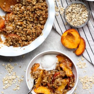 Easy peach crisp with a scoop of vanilla ice cream