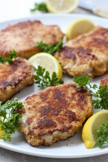 A plate of Lemon Butter Parmesan Crusted Pork Chops