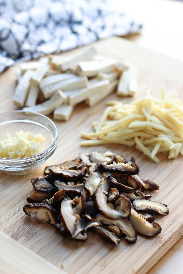 Shiitake mushrooms, bamboo shoots, tofu, and minced garlic for Hot and Sour Soup