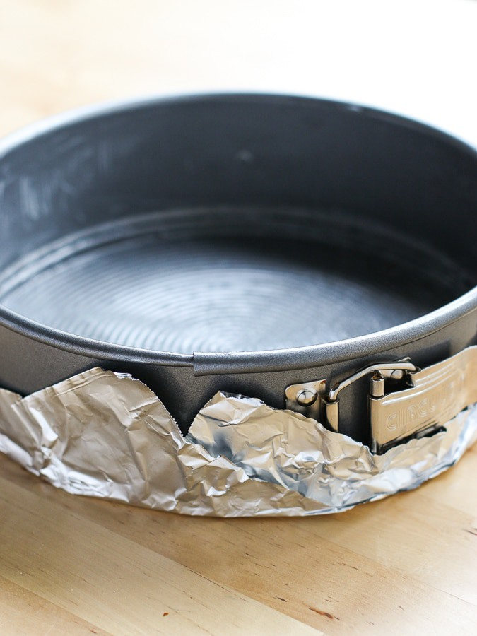 Wrap aluminum foil around spring foam pan for making The Best Cheesecake Ever