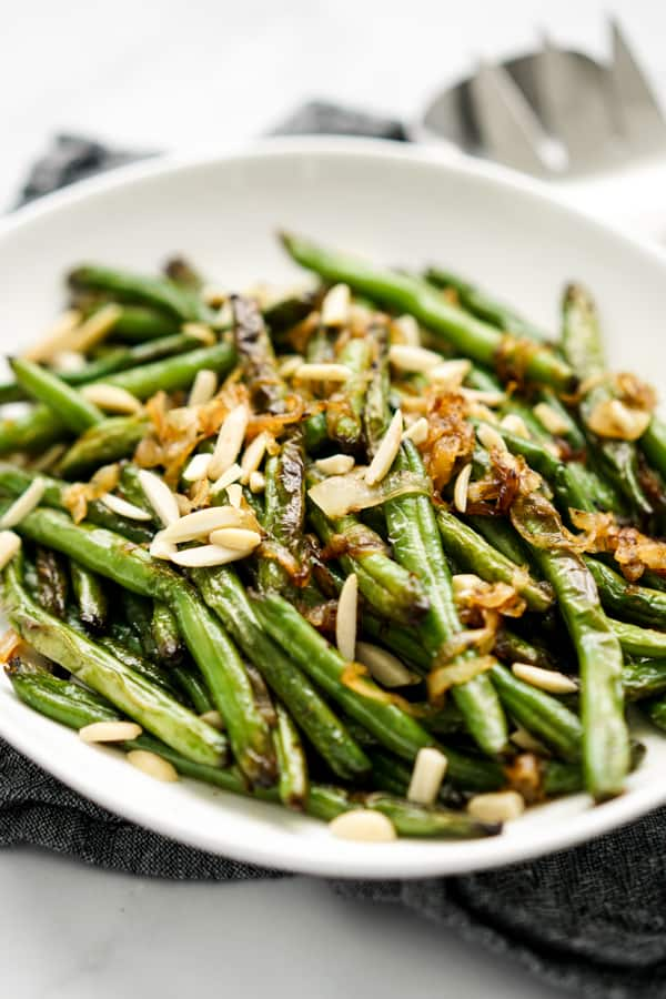 Side with of a plate of Caramelized Onions Sautéed Green Beans
