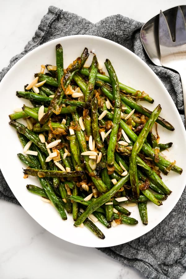 Top down of a plate of Caramelized Onions Sautéed Green Beans