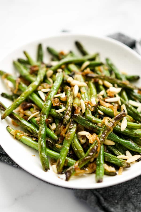 Side view of a plate of Caramelized Onions Sautéed Green Beans