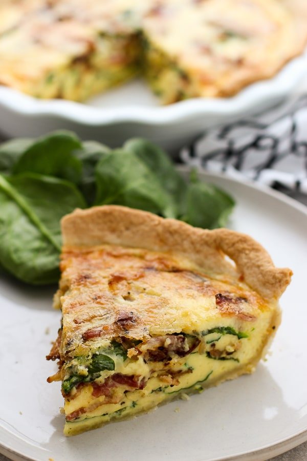 A slice of Bacon Spinach Cheddar Quiche