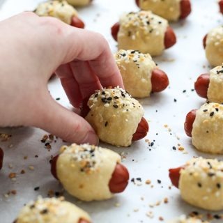 Grabbing a Pigs in the Blanket fresh from the oven