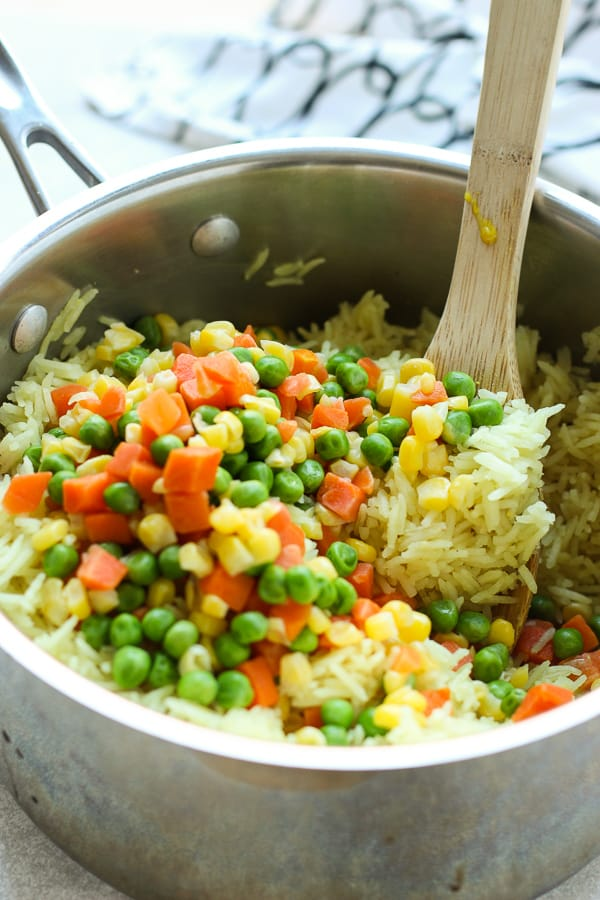 Easy Mixed Vegetable Rice in a pot with wooden spatula
