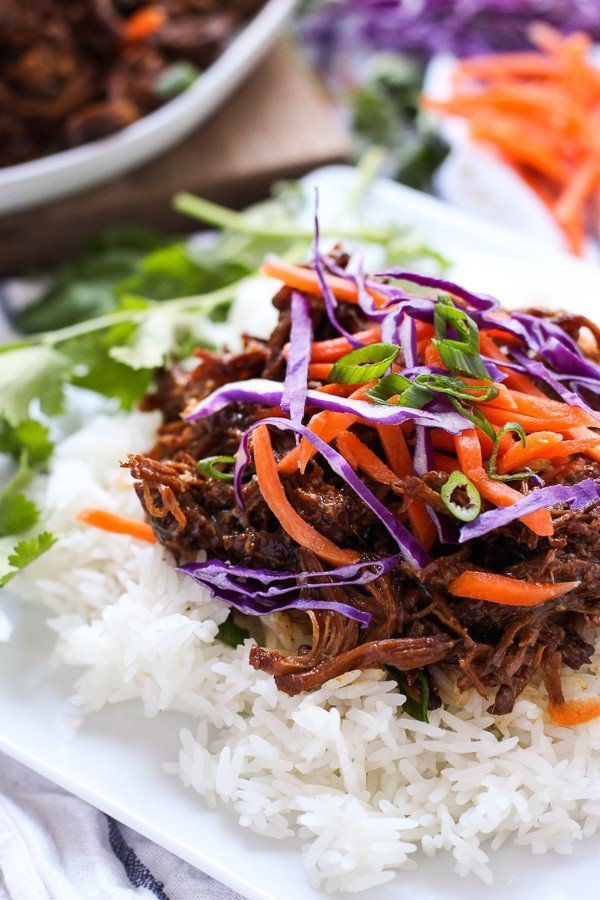 Slow Cooker Asian Shredded Pork on top of a bed of rice
