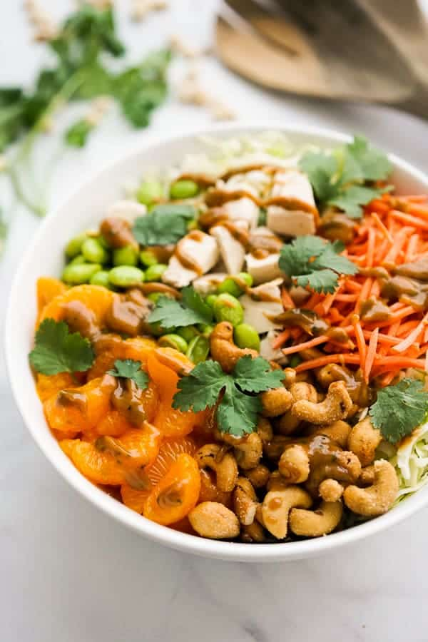 A bowl of salad with Asian Peanut Dressing