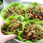 hand grabbing one of the Asian Lettuce Wraps