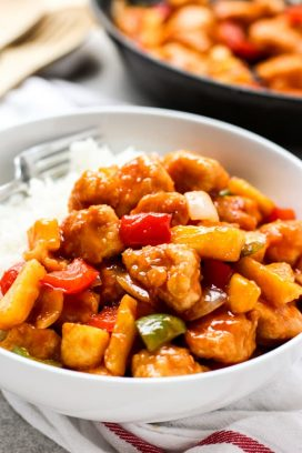 A bowl of Sweet and Sour Chicken with rice