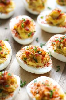 Upclose shot of Bacon Deviled Eggs on a wooden board