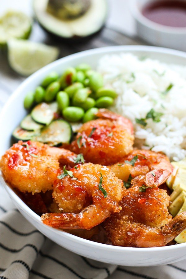 Closeup of Crispy Shrimp Bowl with sauce in the background