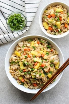 A large bowl and a small bowl of Thai Pineapple Fried Rice