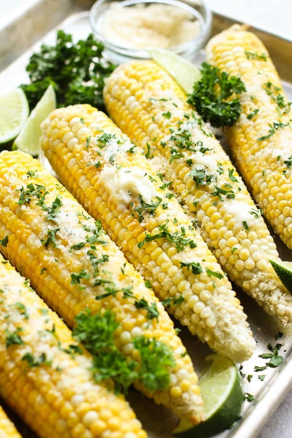 Oven Roasted Corn on the Cob with melted butter, parmesan cheese and parleys