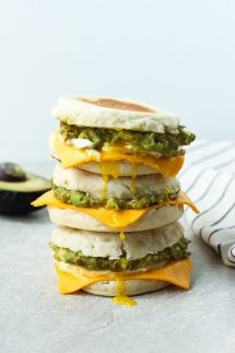 Three breakfast sandwich stacked on top of each other