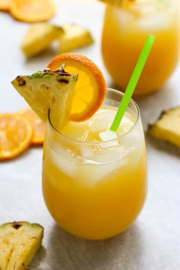 Two glasses of Orange and Pineapple Coconut Rum Cocktail