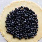 fresh blueberries on a round pie crust