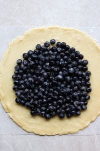fresh blueberries on a round pie crust
