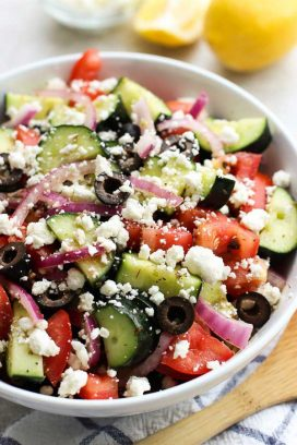 A large bowl of cucumber, tomatoes, red onions and olives tossed in Greek Lemon dressing.