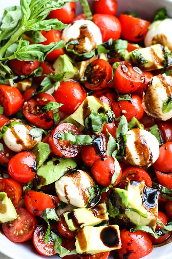 Closeup of caprese salad with avocado