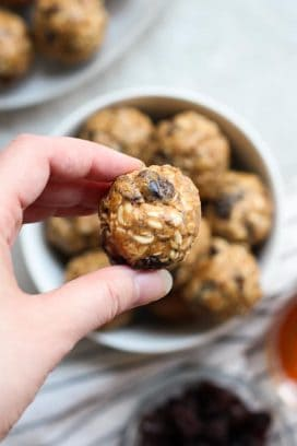 Holding up a Almond Butter Energy Ball