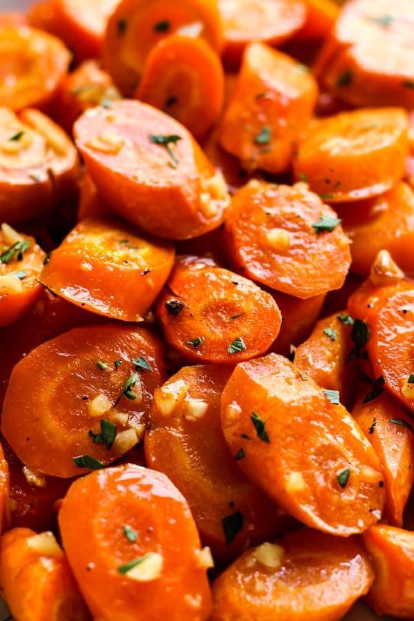 Closeup of A plate of Garlic Honey Roasted Carrots