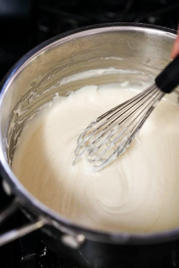 Whisking mixture in a pot
