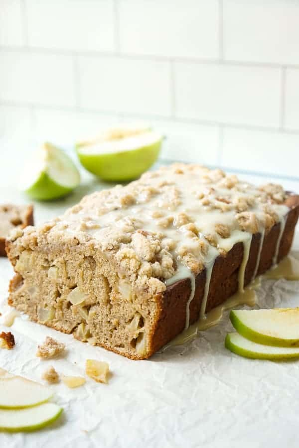 A loaf of Apple Cinnamon Bread with condensed milk drizzle