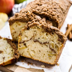 Slices of Apple Cinnamon Bread in front of a loaf