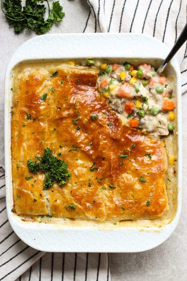 A top down view of chicken pot pie filling top with a layer of puff pastry