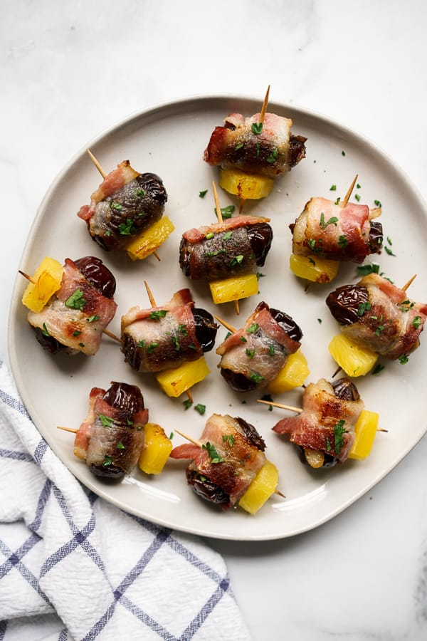 A plate of Bacon Wrapped Dates with Pineapple