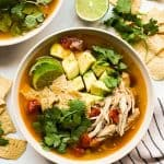 Top down view of a bowl of chicken tortilla soup