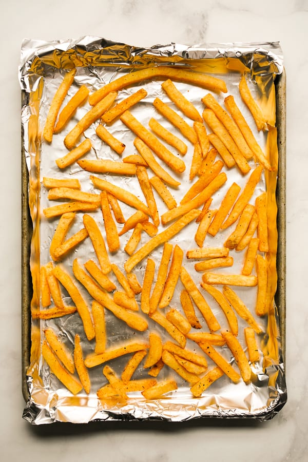 Baked fries on a baking sheet