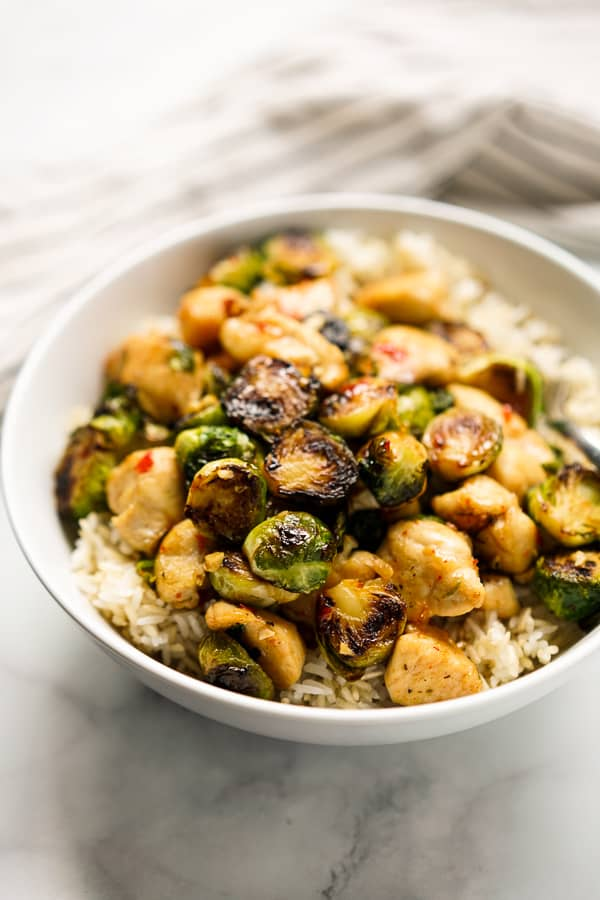 A bowl of brussels sprouts and chicken with rice