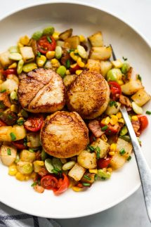 Garlic butter scallops on a bed of Succotash made with potatoes, corn, and lima beans
