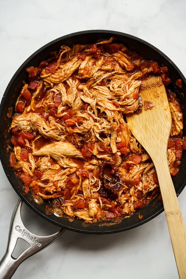 Cooking shredded chipotle chicken on a skillet