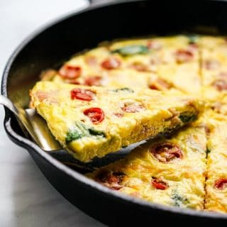 Lifting up a triangular slice of frittata