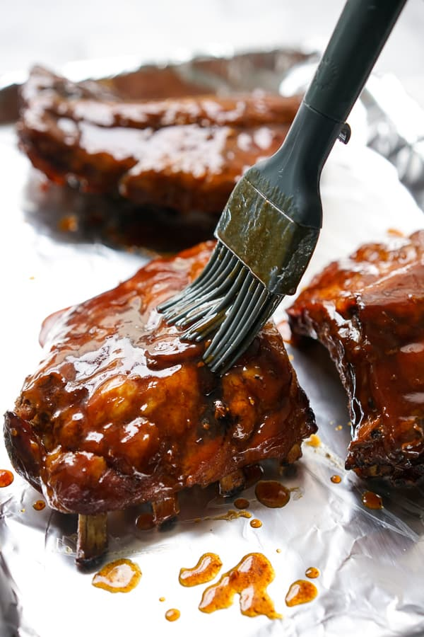 Brushing sauce onto Slow Cooker Asian Ribs