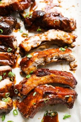Sticky ribs lined up on a pan