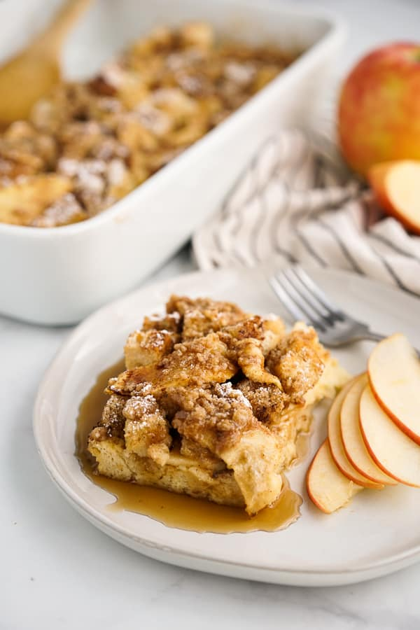 A plate of Apple French Toast Bake with maple syrup on it