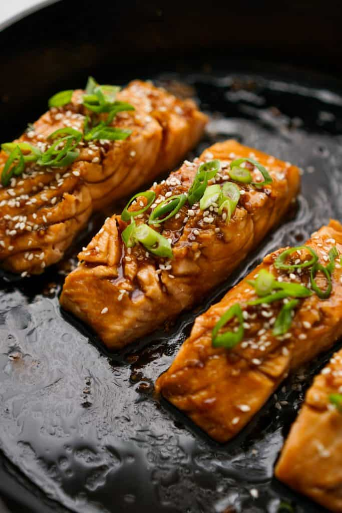 Teriyaki glazed salmon on skillet