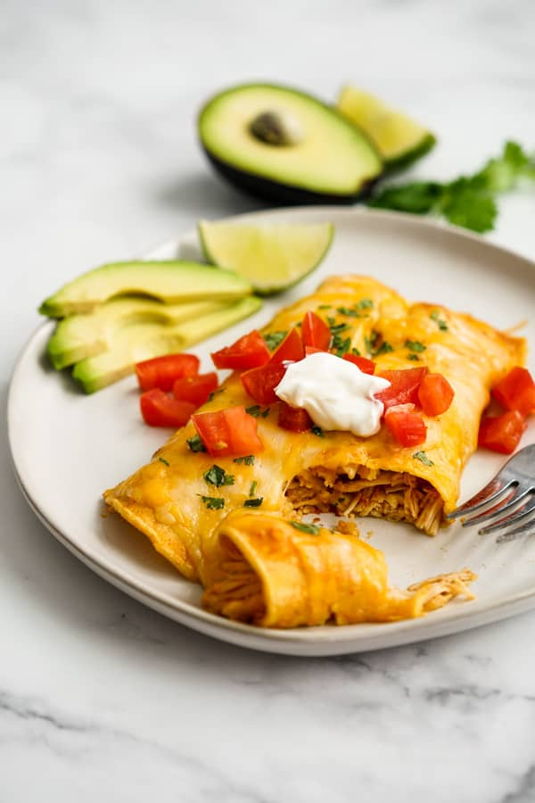 Instant Pot Chicken Enchilada that has been cut into with a fork