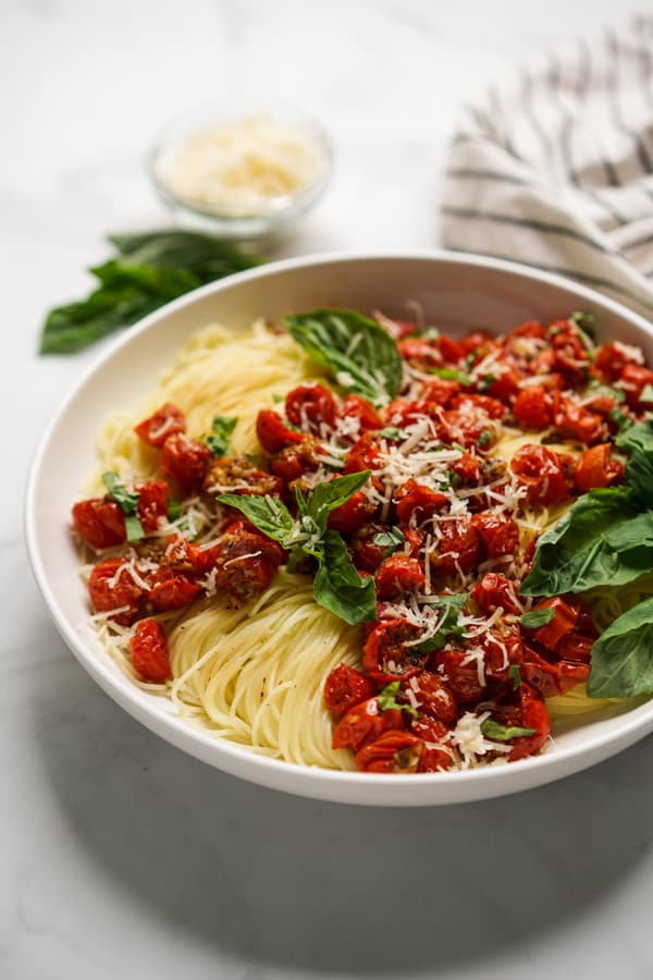 A bowl of Roasted Tomato Pasta with parmesan and fresh basil